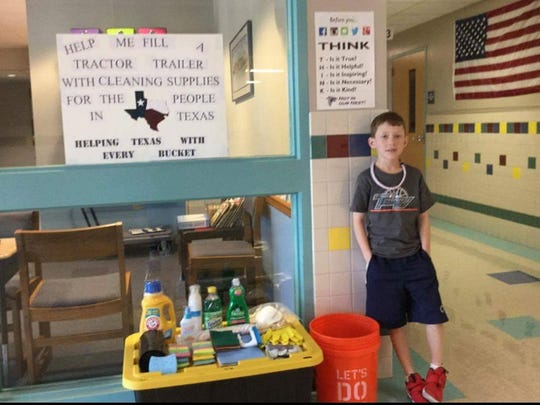 Corbin Hoffmaster, stands next to a collection point at East Hanover Elementary School in Dauphin County. His mother,Stephanie Hoffmaster, hopes to fill a tractor trailer full of buckets with cleaning supplies for the victims of Hurricane Harvey in Texas.