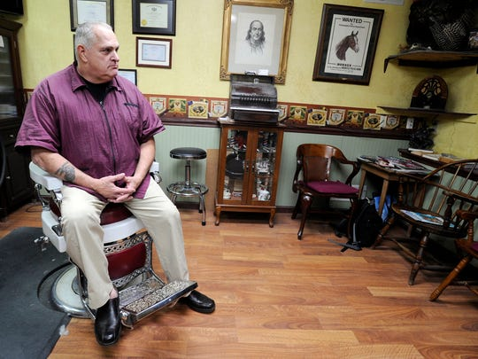 Former Red Lion police chief Walt Hughes, pictured in his barbershop in 2012, theorizes that Jimmy Sheets had no intention of shooting his principal.