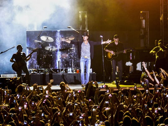 Tim McGraw performs in front of an estimated 25,000