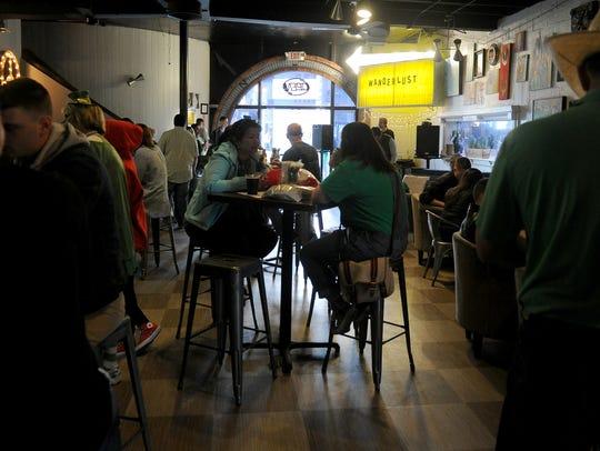 St. Patrick's Day Street Festival revelers drink, chat