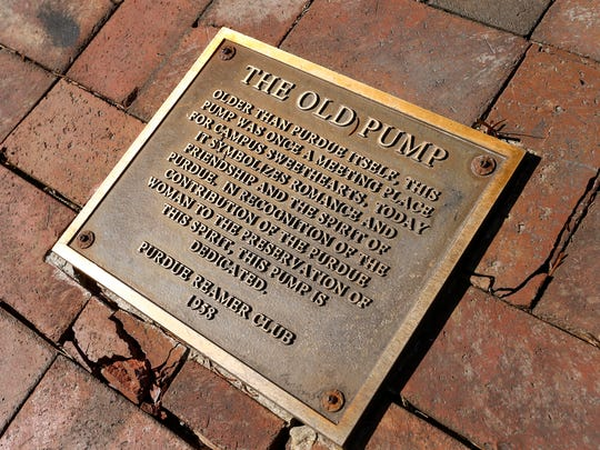 Plaque as the base of The Old Pump Thursday, March