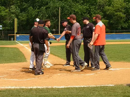 Coaches and captains from St. Joseph (in green) and Pascack Hills (in gray) shake hands prior to Saturday's Bergen County baseball semifinal at NV/Demarest. Pascack Hills won, 10-6.