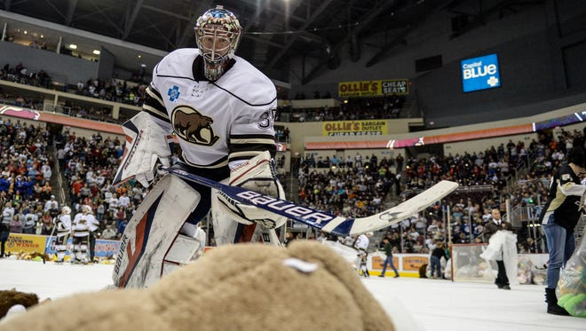Hershey Bears' Justin Peters helps pick up stuffed animals as the Hershey Bears defeated the Wilkes-Barre/Scranton Penguins 4-1 during the annual Teddy Bear Toss night on Sunday, December 6, 2015. By the end of the night 18,115 stuffed animals were tossed on the ice to be donated to local charities.