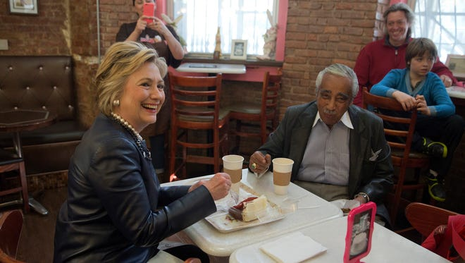 Hillary Clinton and Rep, Charlie Rangel, D-N.Y., meet over coffee and cake at Make My Cake Bakery on March 30, 2016, in Harlem.