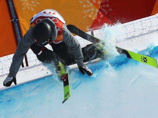 Joel Gisler of Switzerland crashes during his men's