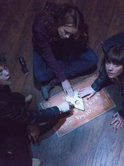 "This photo provided by Universal Pictures shows, from left, Douglas Smith, as Pete, Olivia Cooke, as Laine, and Ana Coto, as Sarah, in the film, ""Ouija.""  (AP Photo/Universal Pictures, Matt Kennedy)"