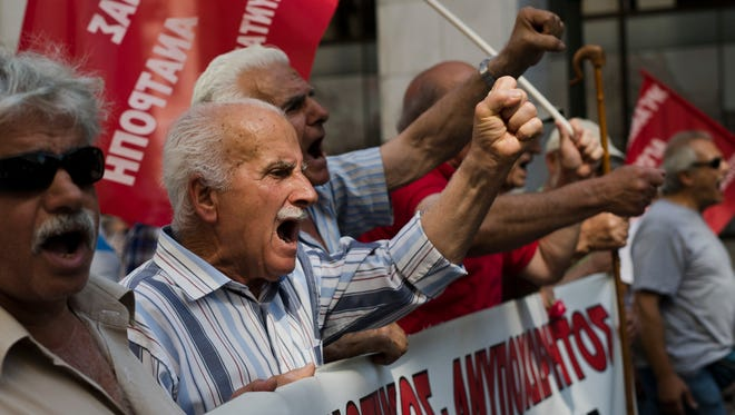 Greek pensioners chant anti-austerity slogans during a protest in central Athens on June 15, 2017.