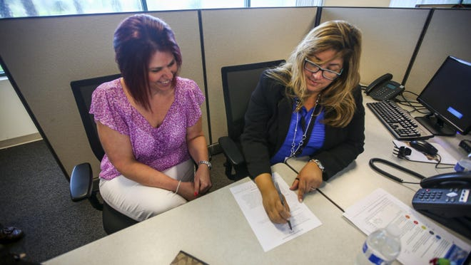Rosie Rivera, an Alta Resources team leader, right, conducts an interview with Tammy Salazar at a previous job fair.
