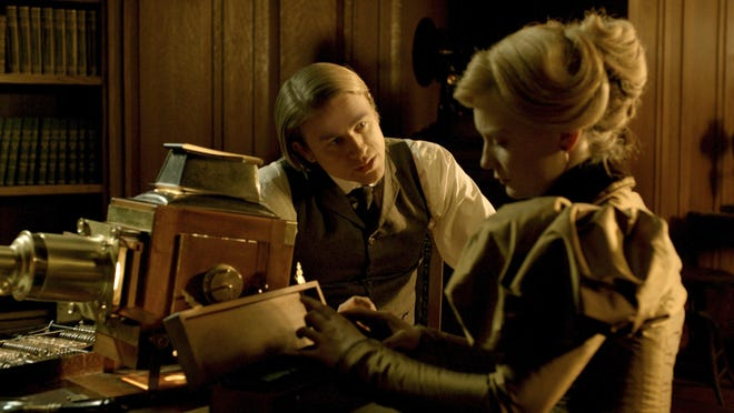 """Charlie Hunnam, left, and Mia Wasikowska appear in a scene from """"Crimson Peak."""""""