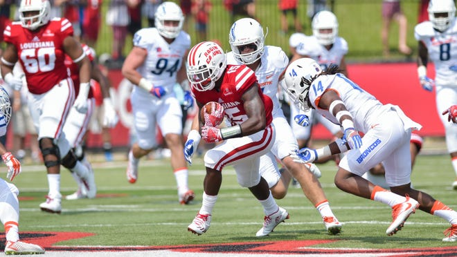 UL's Elijah McGuire tries to elude a Boise State defender during Saturday's 45-10 loss at Cajun Field.