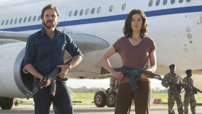 "Daniel Brühl and Rosamund Pike play German radicals Wilfried Bose and Brigitte Kuhlmann in ""7 Days in Entebbe."""