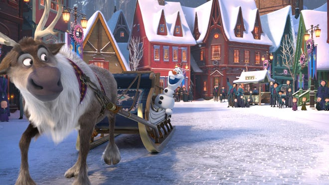 "A screenshot of Sven the Reindeer and Olaf in ""Olaf's Frozen Adventure."" (Photo from Disney)"