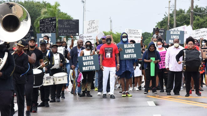 Demonstrators are shown earlier this month at Riviera Beach City Hall. Palm Beach County has seen several peaceful protests following the death of George Floyd in Minneapolis last month.