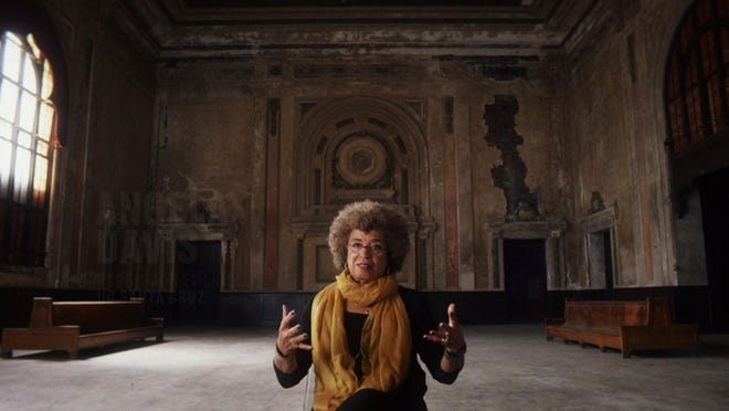 """Angela Davis in the documentary """"13th."""" The title refers to the 13th amendment, which abolishes slavery, except, of course, for criminals, who are stripped of their human rights upon entering and exiting the system."""