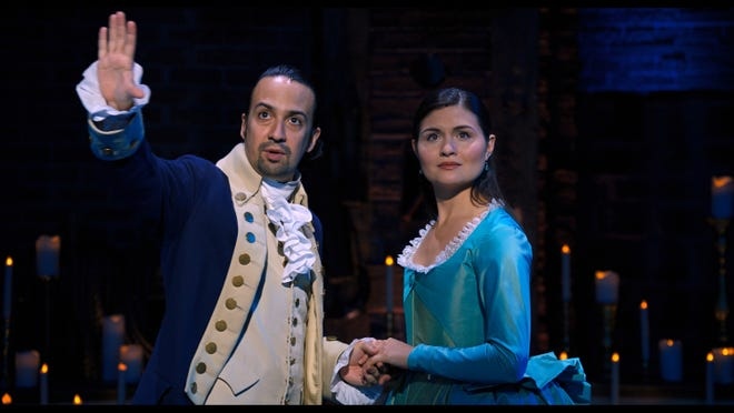 "Lin-Manuel Miranda portrays Alexander Hamilton, left, and Phillipa Soo portrays Eliza Hamilton in a filmed version of the original Broadway production of ""Hamilton."""