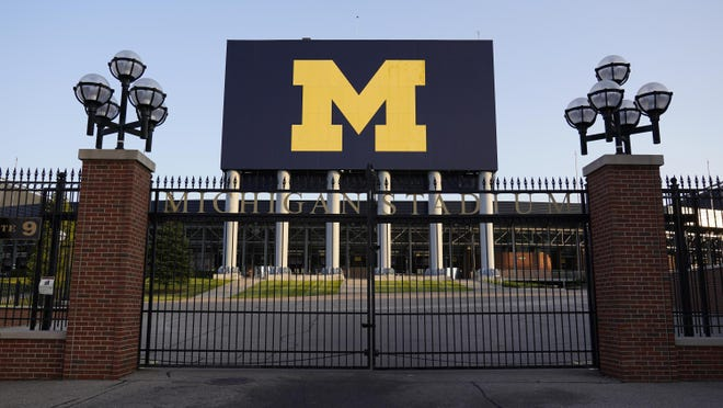 The University of Michigan football stadium is shown in Ann Arbor, Mich., Thursday, Aug. 13, 2020. A crumbling college football season took a massive hit Aug. 11, when the Big Ten and Pac-12, two historic and powerful conferences, succumbed to the COVID-19 pandemic and canceled their fall football seasons.