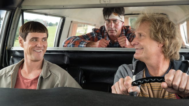 """This image released by Universal Pictures shows Jim Carrey, left, Jeff Daniels, right, and Rob Riggle in a scene from """"Dumb and Dumber To."""""""