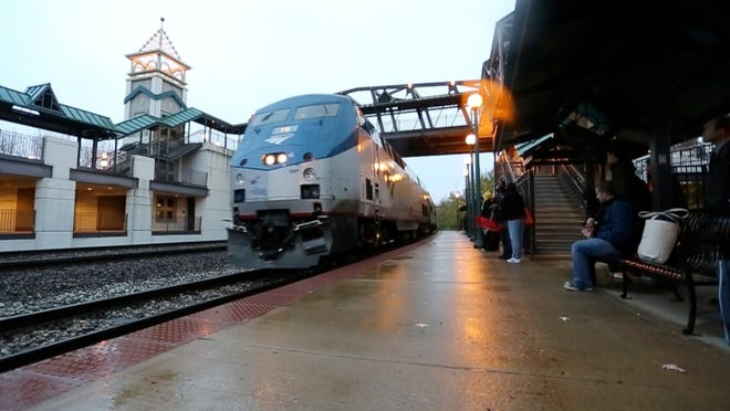 Passengers prepare to board Amtrak's Hoosier State line at the Big Four Depot in downtown Lafayette.