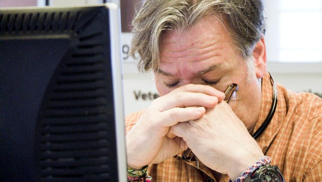 """This photo provided by HBO Documentary Films shows a worker at the suicide prevention hotline during the filming of the documentary """"Crisis Hotline: Veterans Press 1."""""""