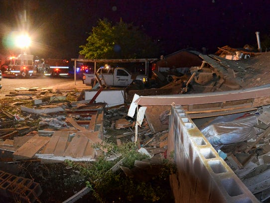 Emergency crews respond to a house explosion in Hobbs,
