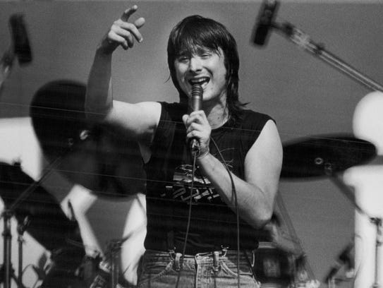 Vocalist Steve Perry performs with Journey in 1983.