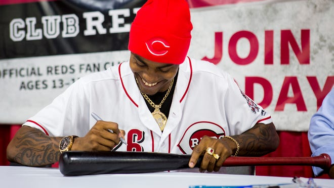 Raisel Iglesias, Reds pitcher, autographs a fan's bat at Redsfest at the Duke Energy Convention Center in downtown Cincinnati Friday, December 2, 2016.