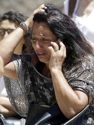 A relative of victims of the attack in Nice, France, reacts to a phone call on July 15, 2016.