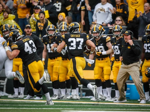 Iowa's Brandon Snyder runs the ball into the end zone