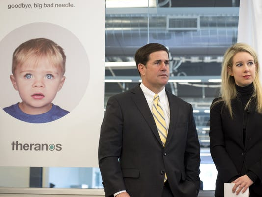 Elizabeth Holmes, CEO and founder of Theranos, with Arizona Gov. Doug Ducey.