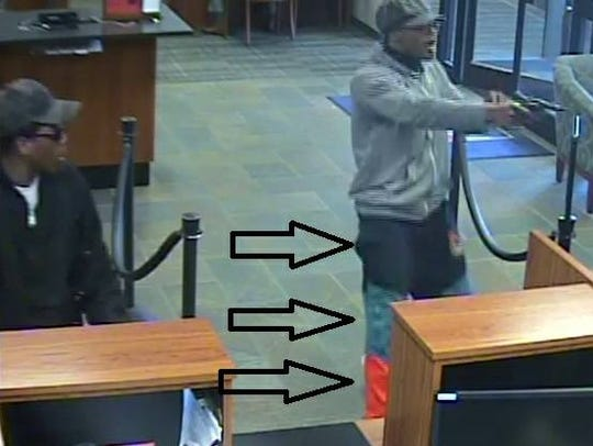 These are images of suspects from a bank robbery in