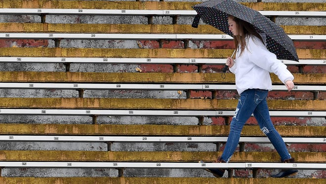 Fans arrive as light rain falls before the Class 1A state championship game between Cornersville and Greenback at Tucker Stadium in Cookeville, Tenn., Thursday, Nov. 30, 2017.