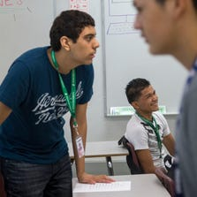 Candido Linares Garcia of Guatemala (seated) attends Alhambra High School with several other migrant youths. This fall, the Phoenix Union High School District has enrolled 88 students who traveled to the United States, many on their own, to escape violence in their home countries in Central America.