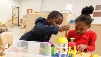 Michael Townsell and Aniyah Cole, both 5, play with Play-Doh at the COA Goldin Center on Dec. 21, 2016. The youth and family center is an anchor institution in the Amani neighborhood.