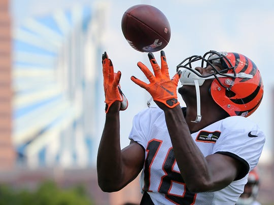 Cincinnati Bengals wide receiver A.J. Green (18) comes down with an over-the-shoulder catch during Cincinnati Bengals training camp practice, Tuesday, Aug. 8, 2017, on the practice fields next to Paul Brown Stadium in Cincinnati.