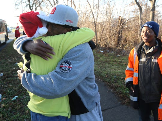 Mrs. Claus gets a big hug from William Calloway, 56 of Lincoln Park after she gave him one hundred dollars while he was waiting for bus on Friday, Dec. 11, 2015.