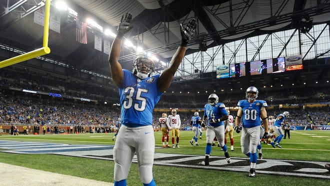 Lions running back Joique Bell plays to the crowd after scoring on a 1-yard run in the second quarter.