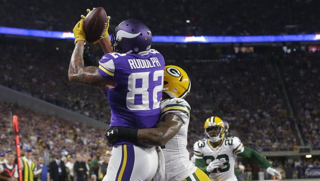 Minnesota Vikings tight end Kyle Rudolph (82) catches a touchdown pass despite the efforts Green Bay Packers strong safety Morgan Burnett (42) during the second quarter of their game at U.S. Bank Stadium Sunday, September 18, 2016 in Minneapolis, Minn.  MARK HOFFMAN/MHOFFMAN@JOURNALSENTINEL.COM