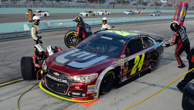 Jeff Gordon gave up second place to take four tires during a caution with 13 laps remaining Sunday.