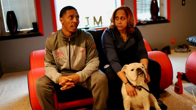 Jarvis and June Mitchell, of Garden City, talk about Martin Luther King Jr. and the realities of life in 2018 for African-Americans. Sitting in on the discussion is the family's English bulldog, Chauncey (named after former Detroit Piston Chaucey Billups).