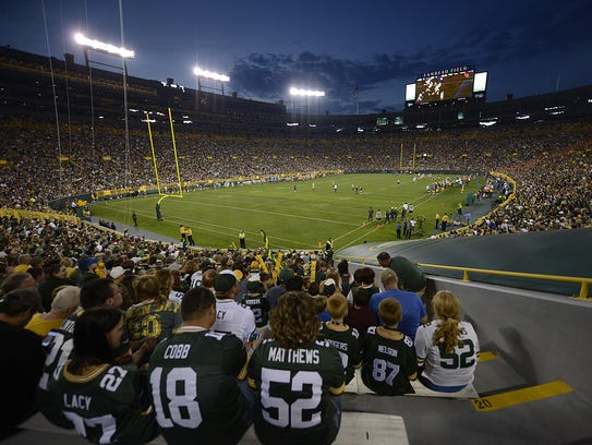 Fans watch the Green Bay Packers during Packers Family