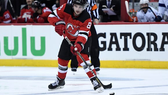 New Jersey Devils defenseman Will Butcher (8) setting