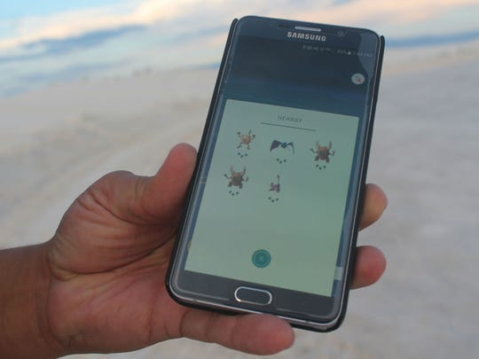 Mark Lujan's phone shows him how many Pokémon were