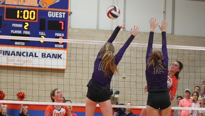 Central High School's Trinity Southall hits the ball past Midland High defenders during a District 2-6A volleyball match Tuesday, Sept. 12, 2017, at Babe Didrikson Gym on the Central campus.