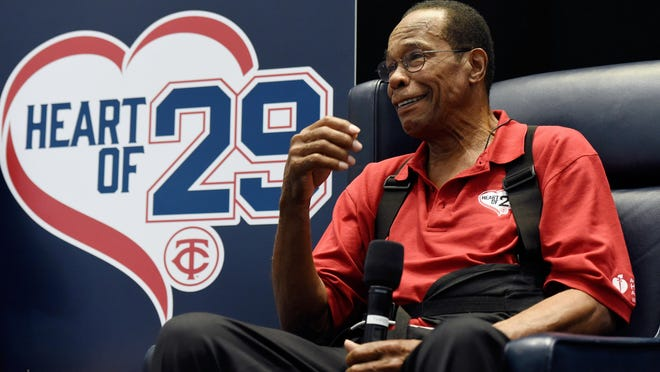 Hall of Famer and former Minnesota Twins baseball player Rod Carew speaks to fans at Saturday's Twinsfest about his recent heart attack. Twinsfest was held in Minneapolis.