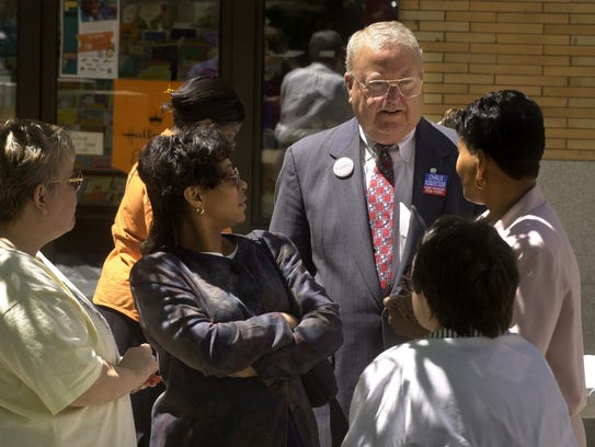 Mayor Charlie Robertson talks with people in the crowd