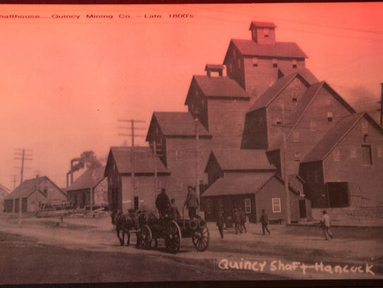 An image of a shaft house at the Quincy Mining Co., taken in the late 1800s, is displayed inside the bar owned by Mike Mallow in Toivola, Mich.