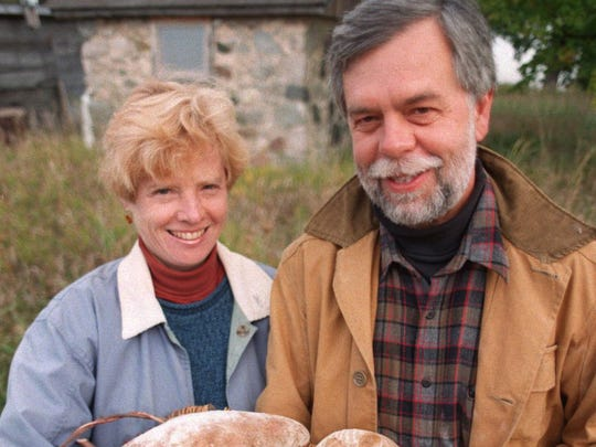 Bob Pisor and his wife, Ellen, show off some Stone House Bread.