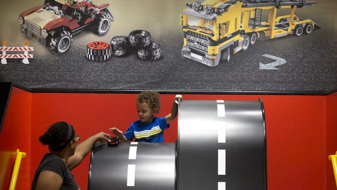 Max Mark (center, 3, Chandler) and his mom, Sasha Mark, play in the Build and Test area, April 22, 2016, at Legoland Discovery Center in Tempe.