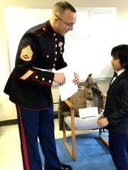 Staff Sgt. Aaron Mowen thanks Maria Montessori student Siddarth Mohindra for a letter he wrote to U.S. military personnel.