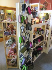 One Fair World repurposed old shutters and bookshelves into display cases.